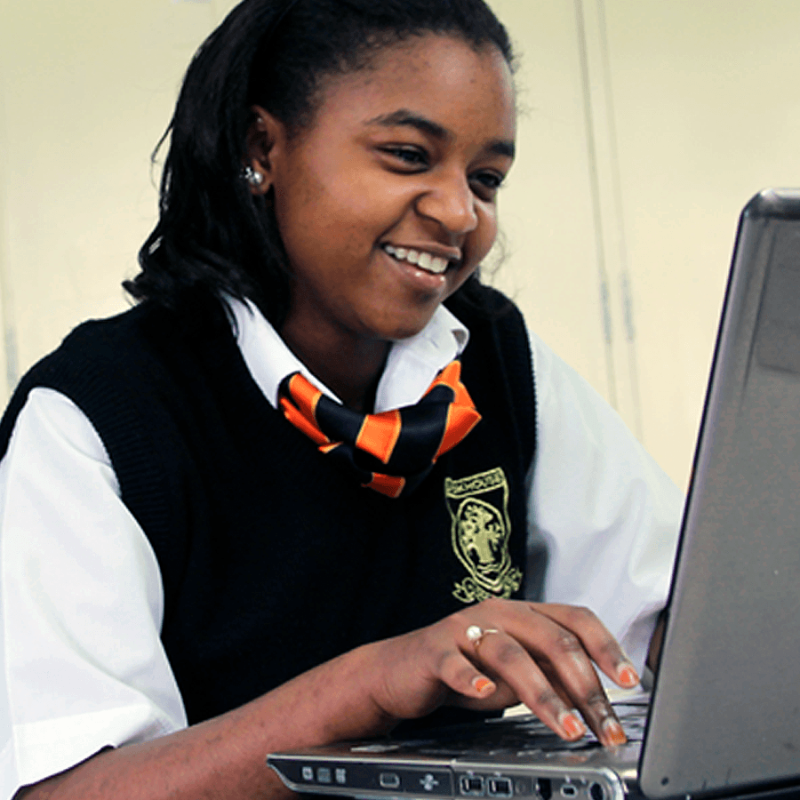 A Brookhouse School student using a laptop for her studies