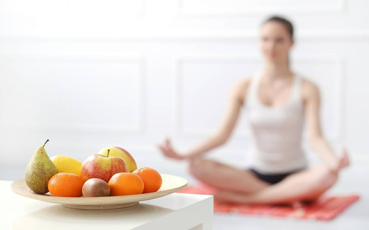 Mediating woman with healthy snacks