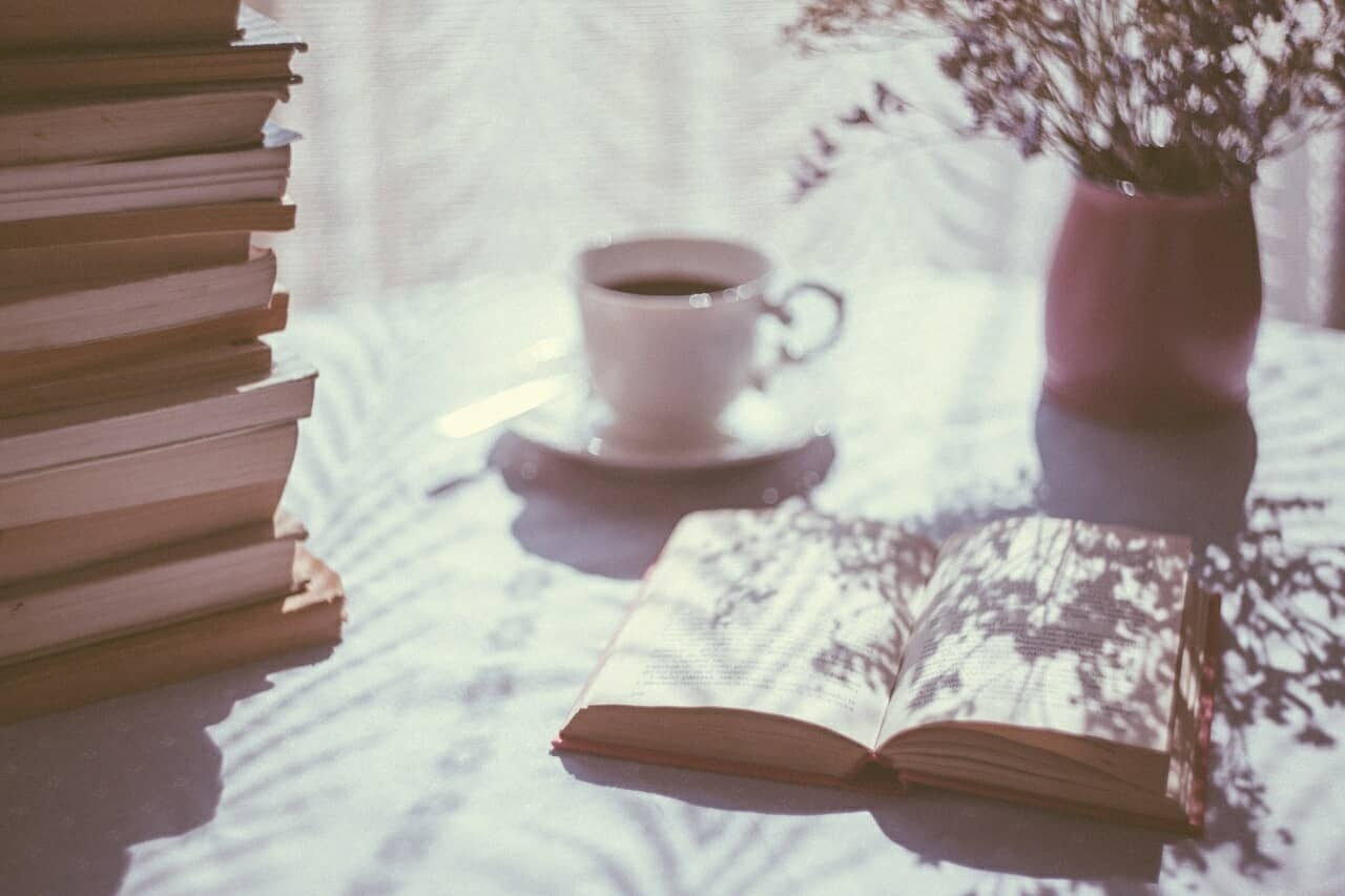 relaxing study scene with coffee flowers and books