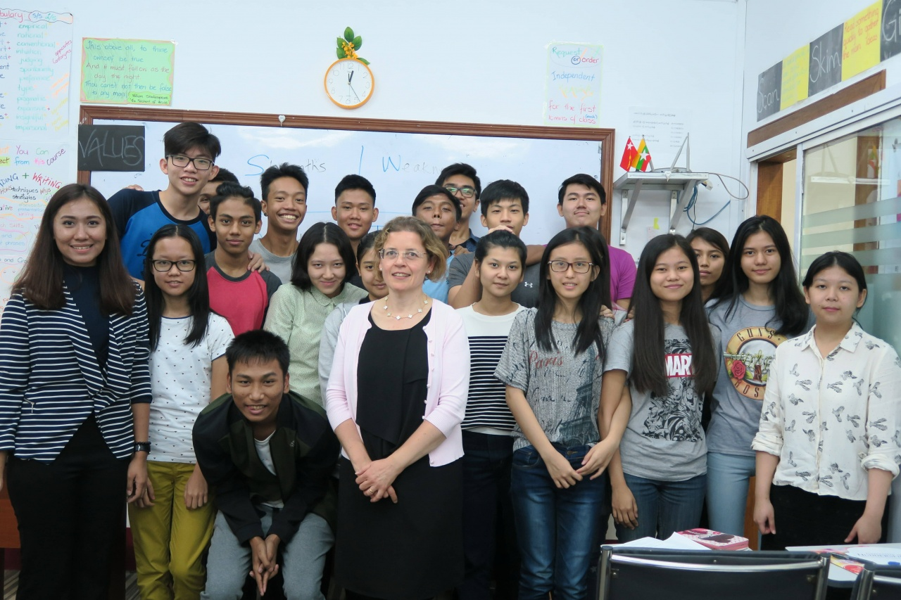 (Photo: Dr Julie Davies, Senior Academic from Huddersfield Business School, with students in the interactive workshop)