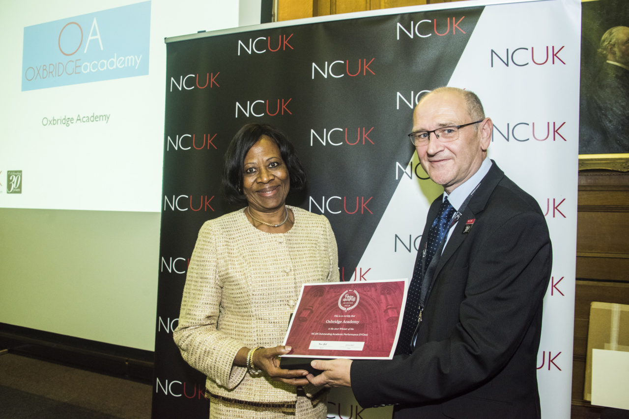 Dr Femi Ogunsanya receiving the NCUK Outstanding Academic Award in 2017 on behalf of Oxbridge Academy.